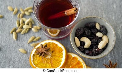 hot mulled wine, orange slices, raisins and spices -...