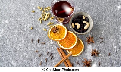 hot mulled wine, orange slices, raisins and spices - ...