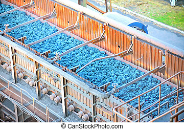 Hot ore on conveyor