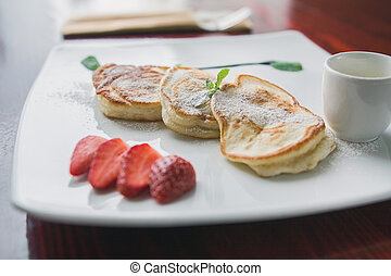 Hot pancake with strawberry and sauce - fritters of cottage cheese, taste breakfast