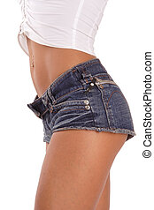 Hot pants - Torso of sportive tanned girl in jeans shorts...