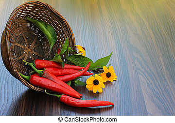 hot pepper with flowers in a basket