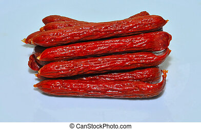 hot pepperoni - pepperoni sticks on blue background