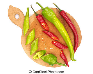 Hot peppers on a wooden board