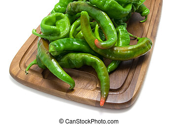 Hot peppers on kitchen board