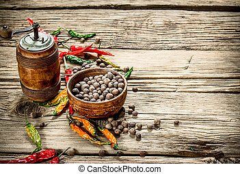 Hot peppers on wooden background.