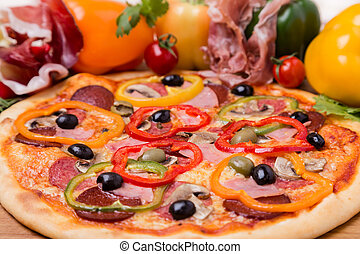 hot pizza with garnish and ingredients