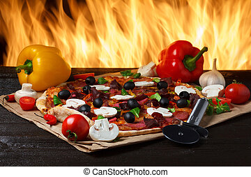 Hot pizza with oven fire