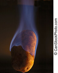 Hot Potato - Baked potato on fire with light from the right
