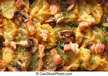 Hot potato with bacon, mushrooms and cheese, background macro
