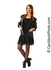 Hot red-haired beauty posing in gothic outfit