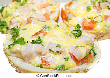 hot sandwiches with ham, cheese, tomatoes and herbs