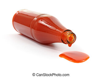 Hot sauce spilling from bottle - A bottle of hot sauce on...