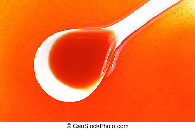 Hot Sauce Spoon Spilled up Close