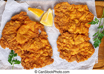 hot schnitzel prepared from veal slices