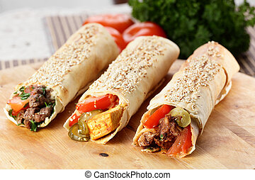 hot fresh and tasty shawarma with vegetables on wooden background
