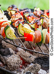 Hot skewers on the grill with fire