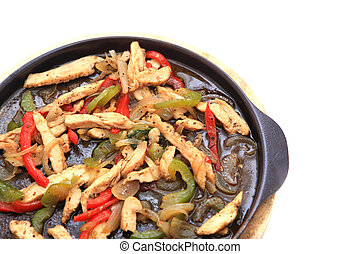 Hot skillet of chicken fajitas and vegetables