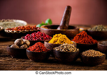 Hot spices in wooden bowls - Traditional oriental spices in...