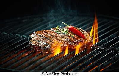 Hot spicy chili steak grilling on a barbecue