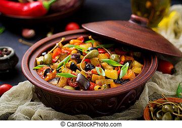 Hot spicy stew (caponata) eggplant, zucchini, sweet pepper,...