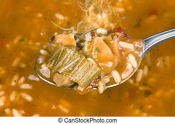 Hot spoon full of soup