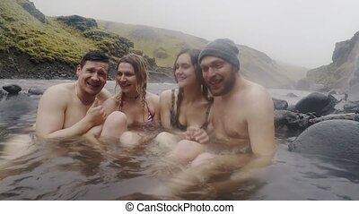 Hot spring geothermal spa on Iceland. Two traveling couple...