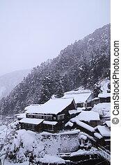 Hot spring resort in snow - Yudanaka hot spring resort in...