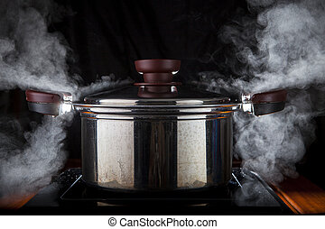 hot steam boiler pot on electric magnetic oven