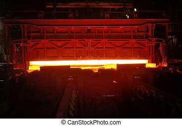 Hot steel on the production line inside of steel plant