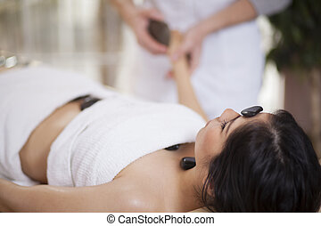 Hot stone massage at a spa
