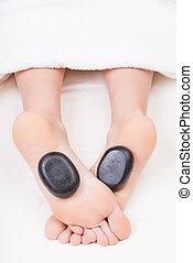 Hot stone reflexology feet massage