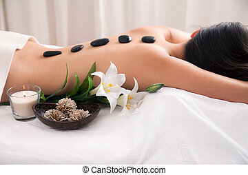 Hot Stone wellness treatment with decoration