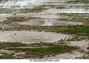 Hot sulfurous gases emerge from a fumarole hot spring in Yellowstone National Park
