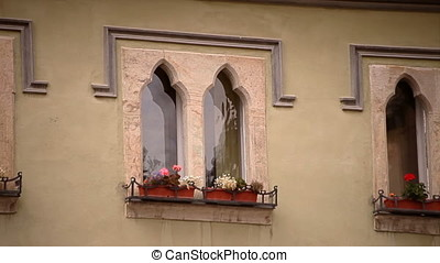 Hot Summer Daylight Medieval Windows With Flowers - Hot...