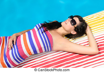 Hot summer - Young woman with colorful dress and sunglasses...