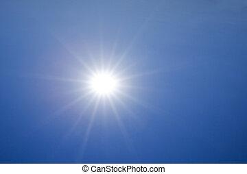 Hot sun over deep blue sky background