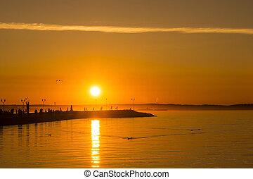 Hot sunset on a lake quay