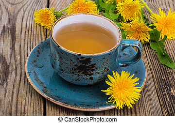 Hot tea and fragrant honey from dandelions in a blue vintage cup