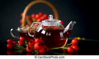 hot tea from medicinal fruits of red ripe rosehip, isolated...