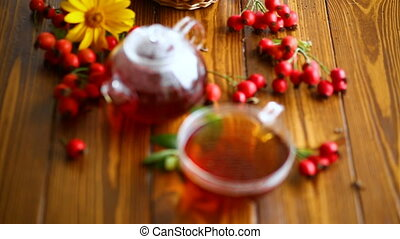 hot tea from medicinal fruits of red ripe rosehip, on a...