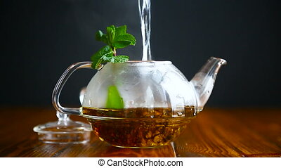 hot tea in a glass teapot