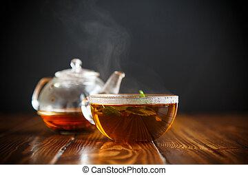 hot tea in a glass teapot