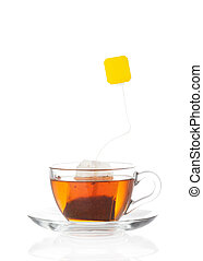 Hot tea in transparent glass cup with label