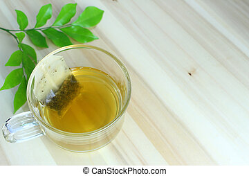 Hot tea with green leaves