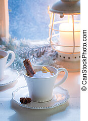 Hot tea with orange and cinnamon for Christmas