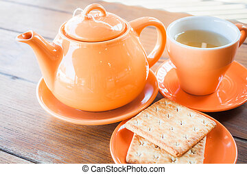 Hot teapot and ceramic cup, stock photo