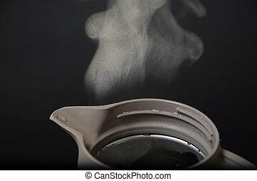 Hot teapot with smoke
