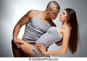 hot-tempered couple with guy holding girl in sexy way...