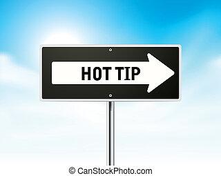hot tip on black road sign